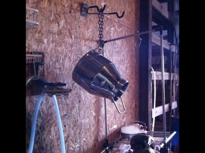 "Milking jug hung to air-dry over ""clean"" milking station."